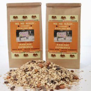 Two bags of healthy pancake mix with organic muesli recipe loosely in front of bags