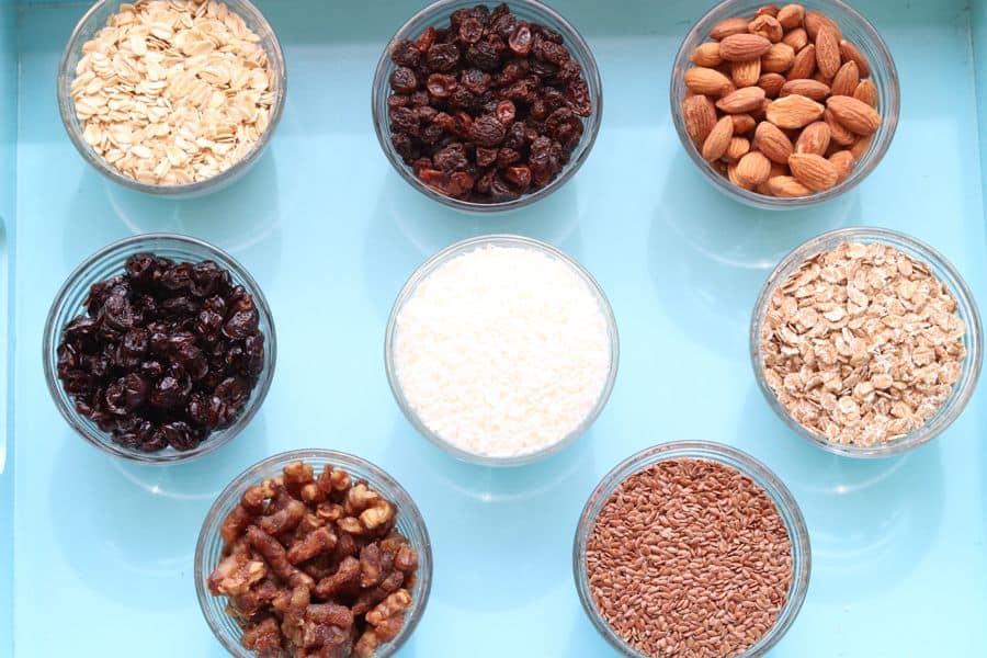 Bowls of ingredients used to make muesli cereal