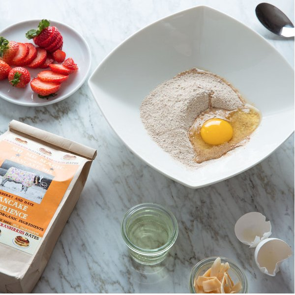 Healthy Pancake Recipe with 1 cup mix, an egg, oil, and strawberries