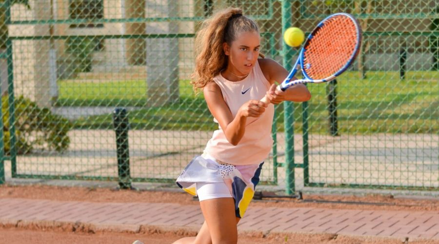 woman playing tennis outside